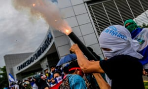A student fires a homemade mortar during a protest to demand President Daniel Ortega resign, in Managua, Nicaragua.