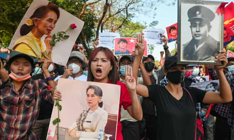 People show the three-finger salute as they rally in a protest against the military coup and to demand the release of elected leader Aung San Suu Kyi, in Yangon, Myanmar