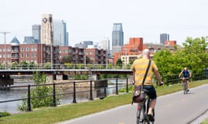 Cyclists pedal along a bike path by the Lachine Canal in Montreal