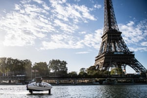 Paris, FranceAn Electric boat called the Sea Bubbles cruises on the river Seine with the Eiffel Tower in background during a test run.