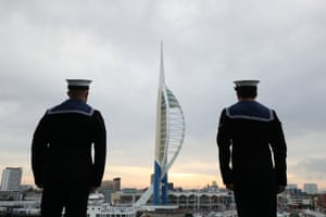 Sailors look out at the Spinnaker Tower