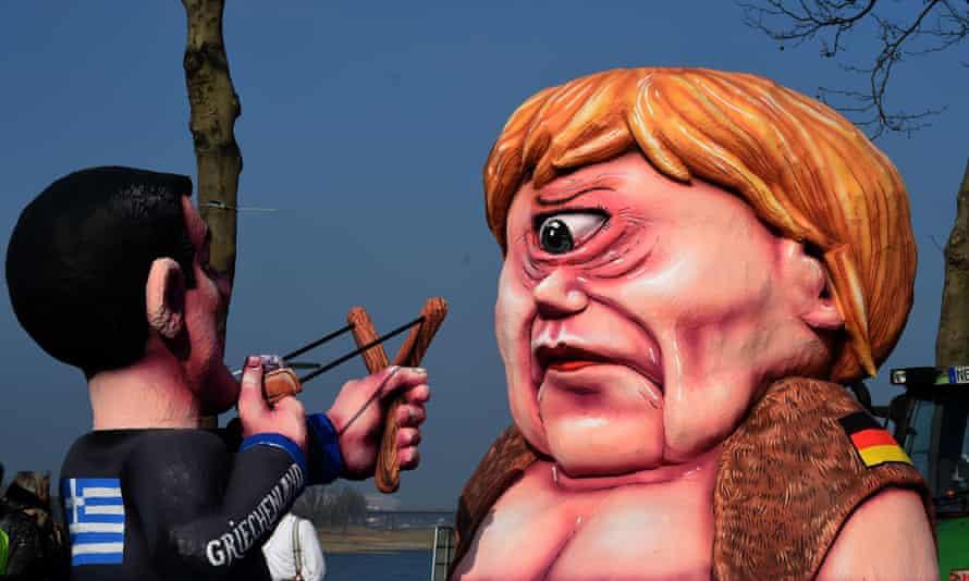 Figures depicting Greek PM Alexis Tsipras and German Chancellor Angela Merkel