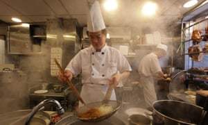 A chef prepares a dish in Hong Kong