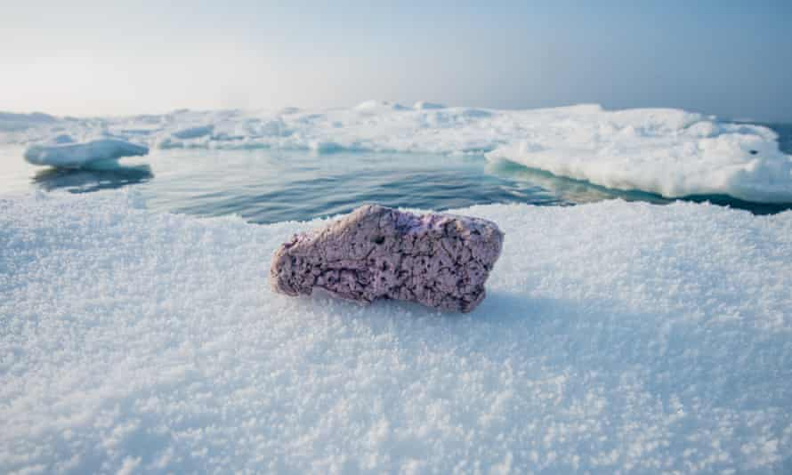 Plastic pollution lying on remote frozen ice in the middle of the Arctic Ocean.