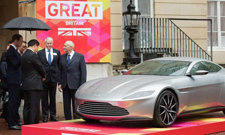 Prince William and Xi view an Aston Martin DB10 sports car at Lancaster House in London.