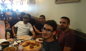 Left to right, Sam Quhshi, Ghamdan Shahbain, Husam Kaid and Younis Ali at the Yemen Cafe, where recent conversation has been dominated by the humanitarian crisis underway in Yemen.