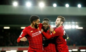 Joe Gomez (left) and Adam Lallana (right) congratulates Divock Origi after his injury time equaliser.