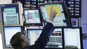 A stock trader works at the New York Stock Exchange, Thursday, Feb. 11, 2016, in New York. (AP Photo/Mark Lennihan)