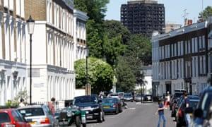 Grenfell Tower seen behind a street in Kensington