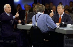 Republican presidential candidates Sen. John McCain, of Arizona, left and Texas Gov. George W. Bush, try to respond to a comment by moderator Larry King, (back to camera) during the Republican presidential debate in Columbia, S.C., Feb. 15, 2000.