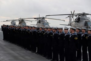 The crew gather before HMS Queen Elizabeth enters Portsmouth