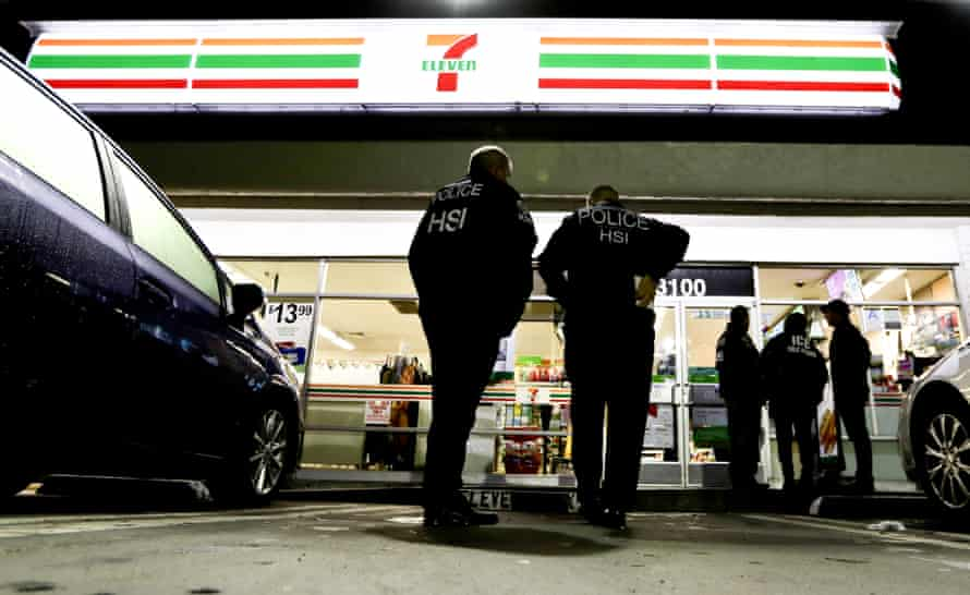 Immigration and Customs Enforcement (Ice) agents outside a 7-Eleven convenience store in Los Angeles, where recent raids were conducted.
