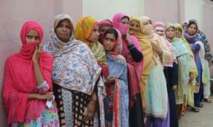 Women queue to cast their vote in Lahore