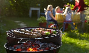 sausages and kebabs on a barbecue