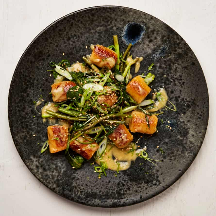 Swede gnocchi with miso butter and morning glory.