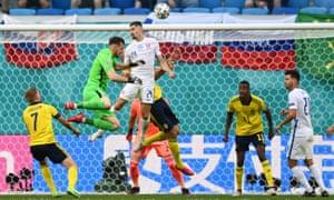 Slovakia's Martin Koscelnik and keeper Martin Dubravka both go for a header at a corner.