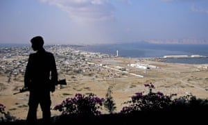 A Pakistani paramilitary soldier stands guard near the Beijing-funded Gwadar 'mega-port'