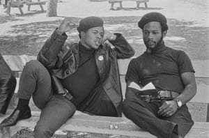 Pirkle Jones, Black Panthers discussing their reading material, Bobby Hutton Memorial Park, Oakland, California, No 101 from A Photographic Essay on The Black Panthers. Commissioned by the Swedish magazine Vi