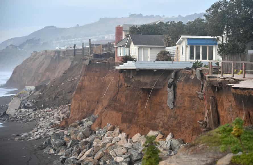 Sections of land are seen missing from coastal properties in Pacifica, California, amid erosion in 2016.