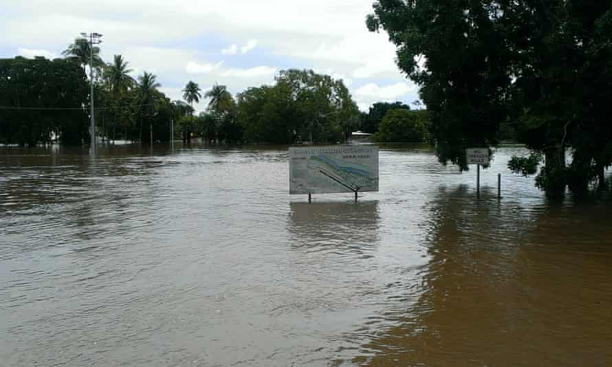 Submerged street signs in the community of Nauiyu in the Northern Territory, where crocodiles were seen on the local football field.