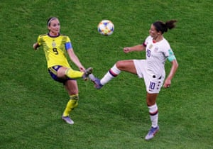 Carli Lloyd of the US (right) and Sweden's Kosovare Asllani challenge for the ball.