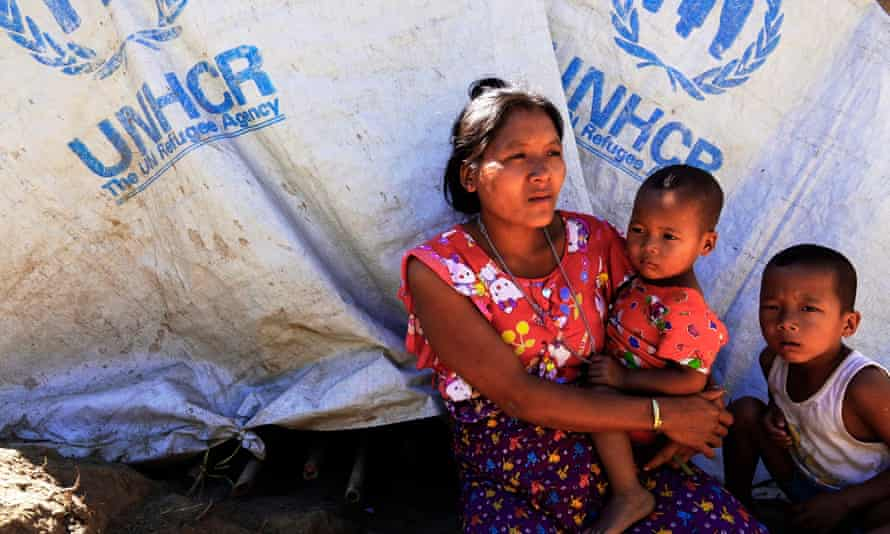 A displaced Rohingya woman and her children at a temporary camp in Rakhine state in December 2018