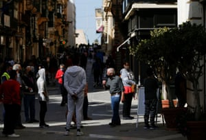 Non-essential shops and services reopen for business after a seven-week-long shutdown in MaltaPeople wearing protective face masks queue to enter a shopping arcade as non-essential shops and services reopen for business after a seven-week-long shutdown because of the pandemic in Valletta, Malta on 26 April, 2021.
