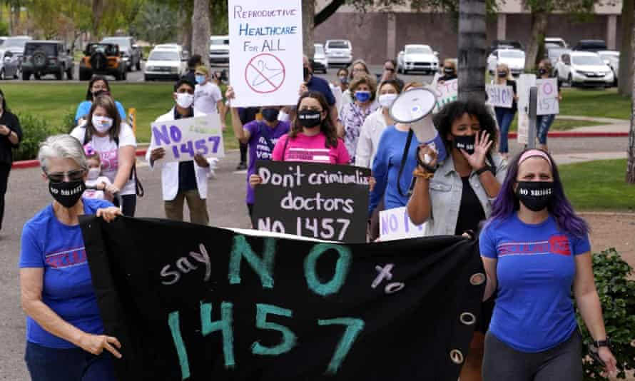 Arizona reproductive rights groups march to deliver a petition to Doug Ducey to veto the latest abortion bill passed by the state legislature.