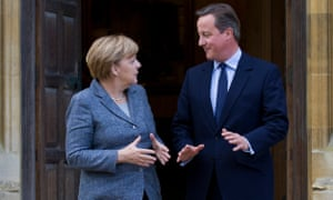 David Cameron and Angela Merkel tackling the issues: the British prime minister is continuing his drive to renegotiate EU membership terms