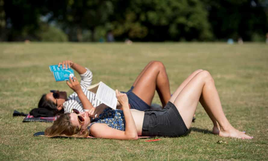 People relax in the sun in Finsbury Park.