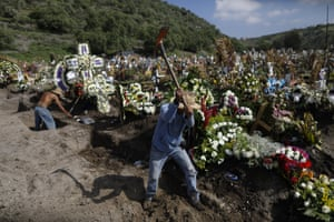 Workers dig fresh graves in a section of the municipal cemetery of Valle de Chalco, on the outskirts of Mexico City to accommodate the surge in deaths amid the Covid-19 pandemic.