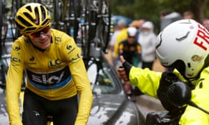 A motorcycle cameraman gives Chris Froome a thumbs up.