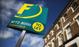 A Foxtons 'to let' sign outside houses