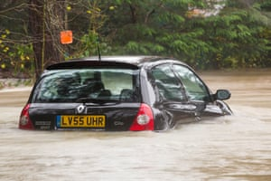 An abandoned car seen in flood waters in Ambleside