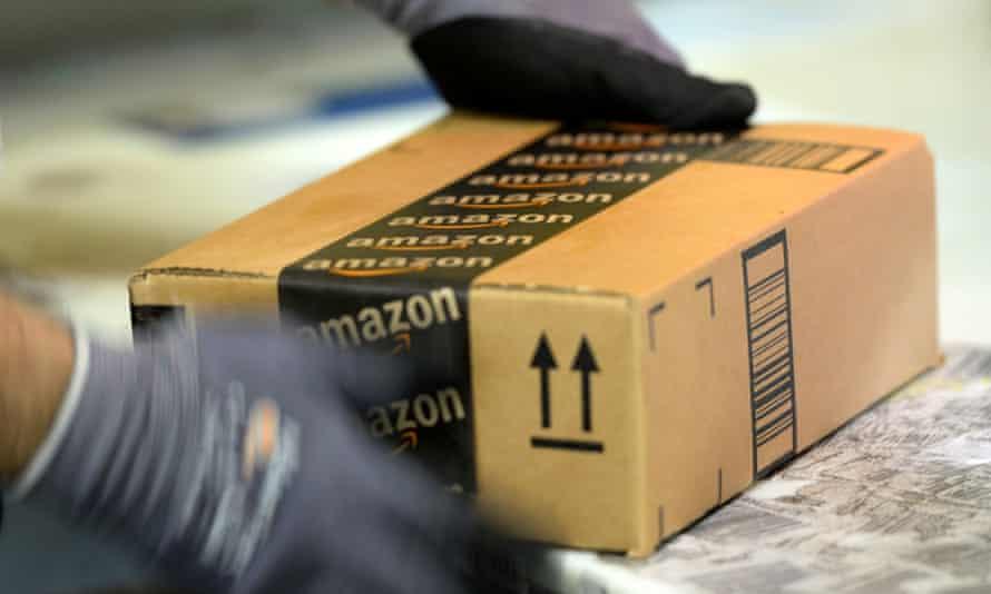An employee prepares order at Amazon's San Bernardino Fulfillment Center.