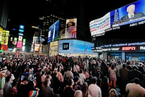 In Times Square, New York, people gather to watch president-elect Joe Biden give his victory speech.