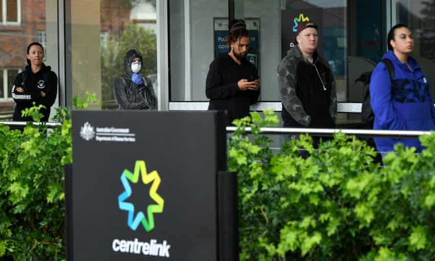People queue outside a Centrelink office in Sydney