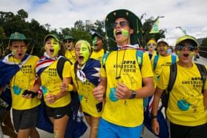 Australian kids singing 'Aussie, Aussie, Aussie' as they enter Melbourne Park.