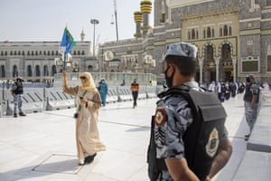 Security personnel standby as limited numbers of pilgrims arrive keeping social distancing.