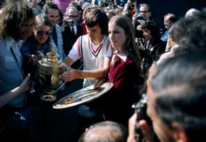 1974 champions Jimmy Connors and Chris Evert are surrounded by the press and photographers as they parade their trophies