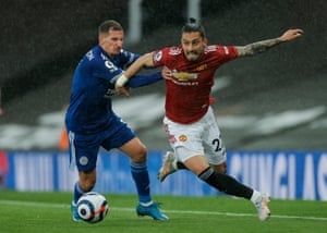 Alex Telles of Manchester United tussles with Marc Albrighton of Leicester City.