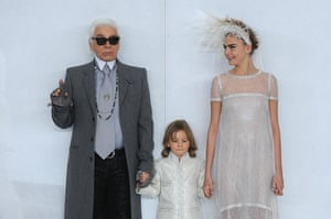 Lagerfeld, his godson Hudson Kroenig and model Cara Delevingne walk the runway during the Chanel show as part of Paris Fashion Week Haute-Couture Spring/Summer 2014