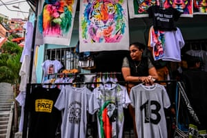 A vendor waits for customers at a T-shirt stall