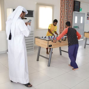 Workers have their photograph taken while playing table football inside the Challenger camp.