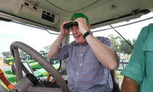 Queensland Opposition Leader Tim Nicholls drives a tractor during a visit to a John Deere dealership in Emerald, Friday, November 17, 2017. Mr Nicholls is on the campaign trail ahead of the November 25 state election. (AAP Image/Dan Peled) NO ARCHIVING