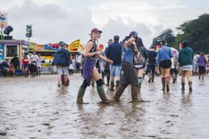 Leeds, UKFestival goers in the mud during the Leeds Festival