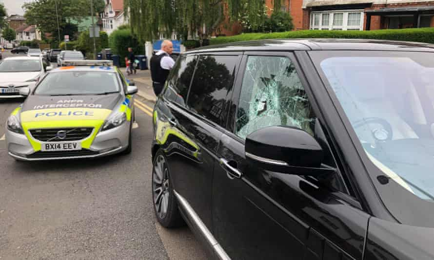 The scene after Michael McIntyre's Range Rover was attacked by a hammer-wielding moped gang.