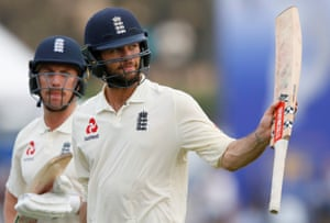 Ben Foakes raises his bat for the England fans as he and Jack Leach walk off the field at the end of play.