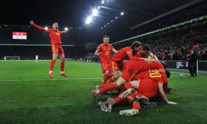 Wales players celebrate the 2-0 win over Hungary that secured their place at Euro 2020.