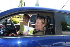Chelmsford, UK. Happy customers after McDonald's reopens one of its drive-through restaurants in Essex